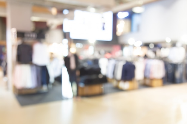 Samenvatting vaag winkelcomplex van warenhuis met mensenachtergrond