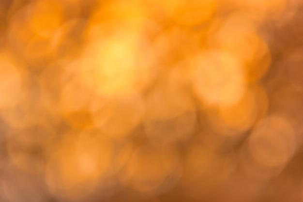 Samenvatting vage goud bruine bokehachtergrond