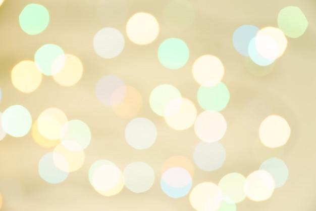 Samenvatting vage lichten op achtergrond in pastelkleuren.
