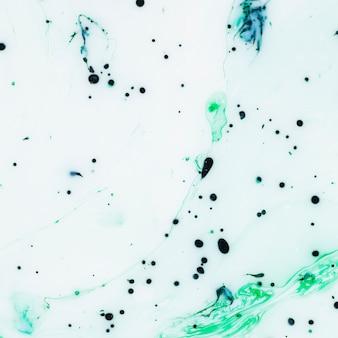 Samenvatting van blauwe inktdruppeltjes in olie