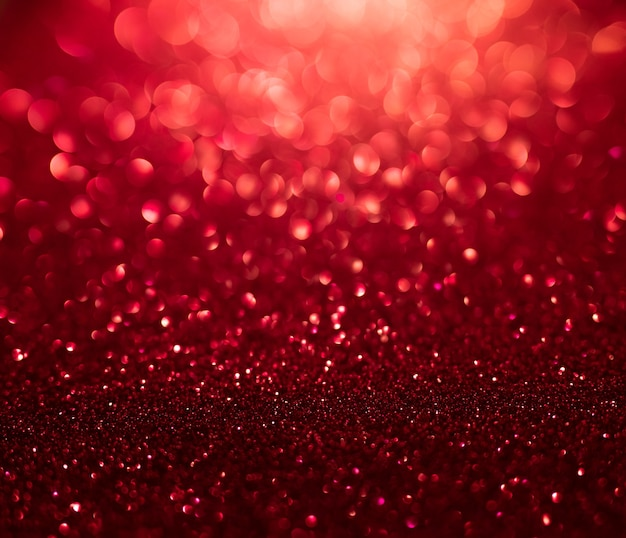 Samenvatting van gouden en rode glitterlichten met bokeh intreepupil achtergrond