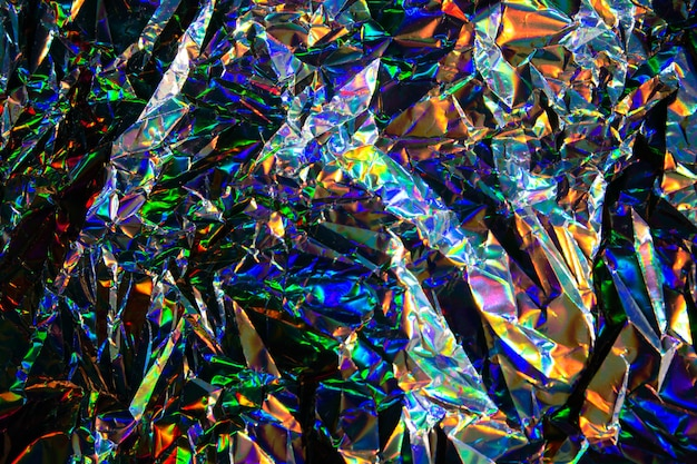 Samenvatting wazig holografische iriserende zeemeermin folie textuur achtergrond. futuristische neon trendy zilveren kleuren