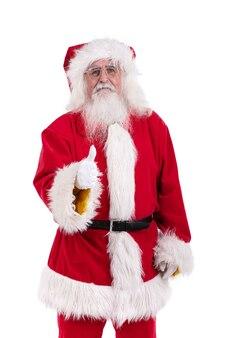 Santa claus duim opgevend tegen witte muur