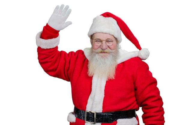 Santa claus glimlachen en zwaaien.