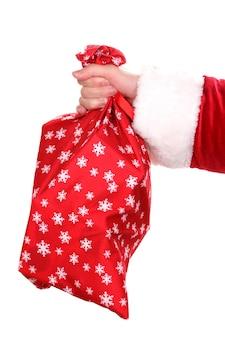 Santa claus hand met zak met geschenken geïsoleerd op wit