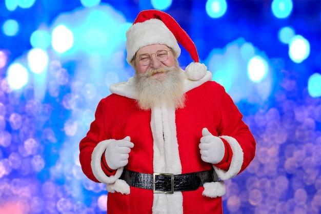 Santa claus op blauwe glanzende achtergrond.