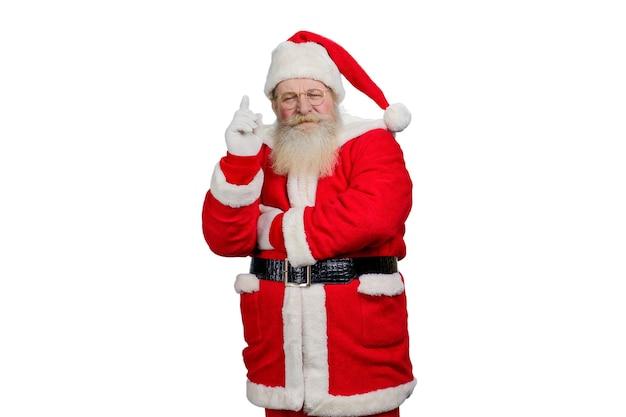 Santa claus verhoogde wijsvinger.