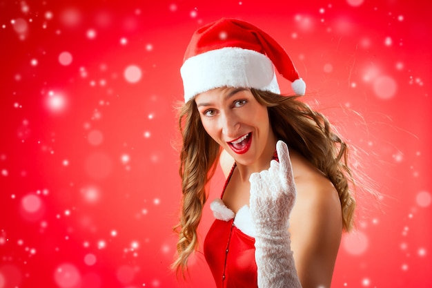 Santa claus-vrouw die u waarschuwen met vinger