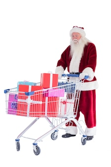 Santa duwt een winkelwagentje met cadeautjes