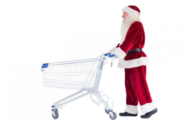 Santa duwt een winkelwagentje