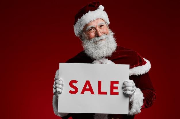 Santa holding christmas sale-teken