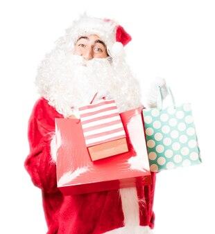 Santa met boodschappentassen van kleuren