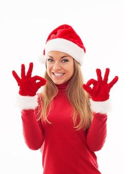 Santa vrouw die een ok teken geeft