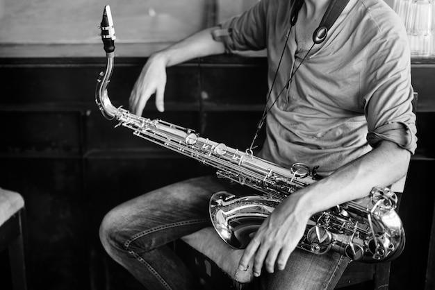 Saxofoon symfonie muzikant jazz instrument concept