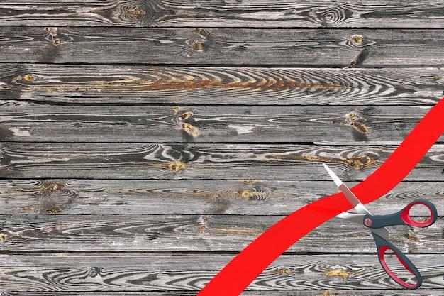 Schaar snijden rood lint met lege ruimte voor uw ontwerp voor houten plank achtergrond. 3d-rendering