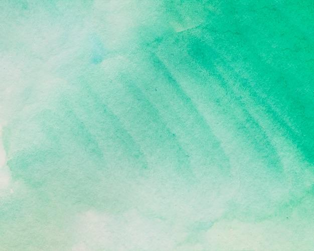 Schaduw van groene geschilderde waterverfachtergrond