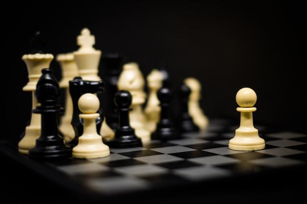 Schaken (pion) voor leider achtergrond of textuur - business & strategie concept.