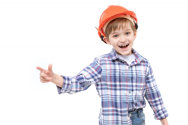 Schattig kind verkleed als voorman in oranje helm en shirt