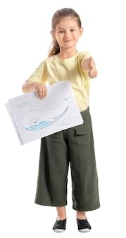 Schattig klein meisje met kleurplaat op wit oppervlak