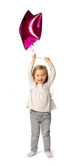 Schattige kleine blonde meisje met paarse stervormige baloon geïsoleerd