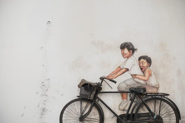 Schilderij van kinderen met echte fiets