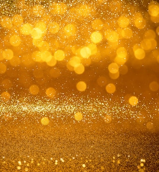 Schitter de gouden uitstekende achtergrond van de lichtentextuur. defocused