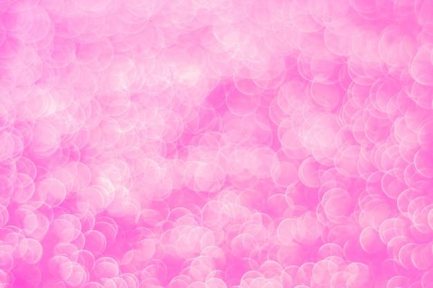 Schitter lichte abstracte roze bokeh huw en valentijnskaartliefdeconcept