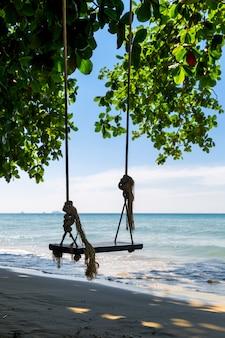Schommels op een strand