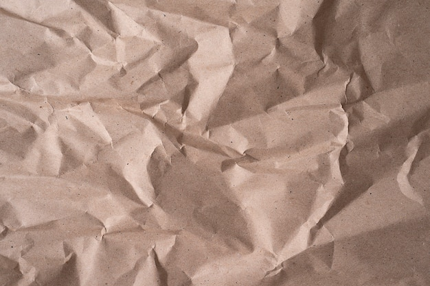 Schone beige kringlooppapier, gerimpelde, abstracte achtergrond voor ontwerp. textuur van beige verfrommeld papier voor achtergrond of behang, close-up afbeelding in hoge resolutie