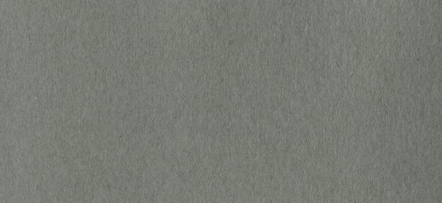 Schone grijze kraftpapier-kartondocument textuur als achtergrond. vintage karton.