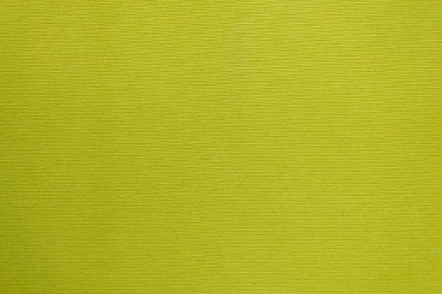 Schone stoffentextuur in helder geelgroen.