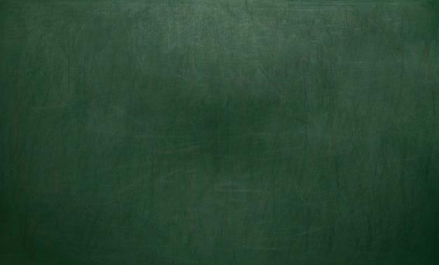 Schoolbord / schoolbord textuur. leeg leeg groen bord met krijtsporen