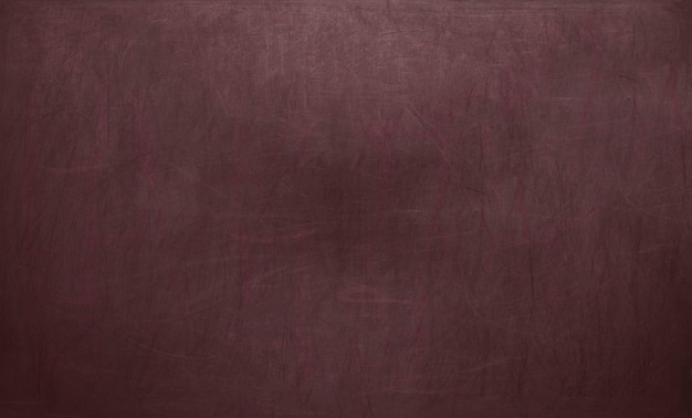 Schoolbord / schoolbord textuur. leeg leeg rood bord met krijtsporen