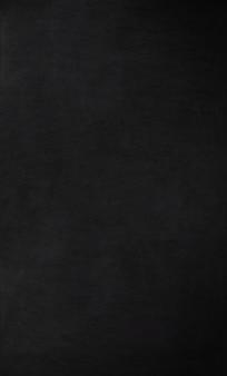 Schoolbord / schoolbord textuur. leeg leeg zwart bord met krijtsporen