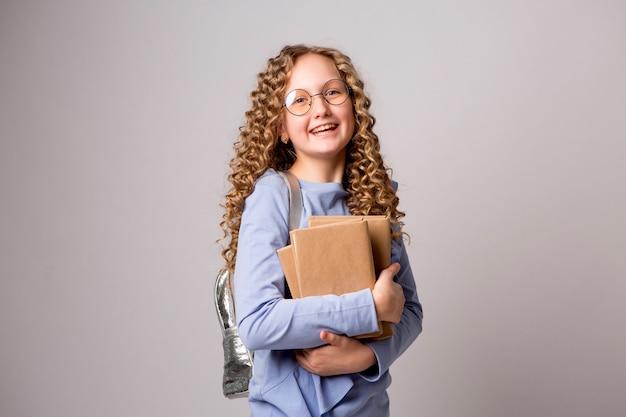 Schoolmeisje met boeken