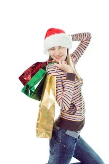 Schoonheid kerst vrouw met cadeau op witte achtergrond