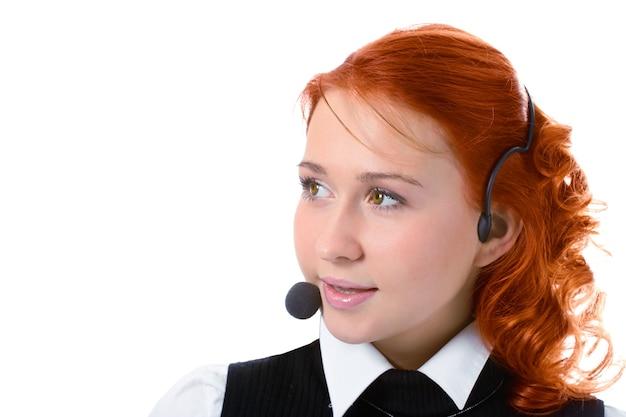 Schoonheid meisje operator met koptelefoon op witte achtergrond
