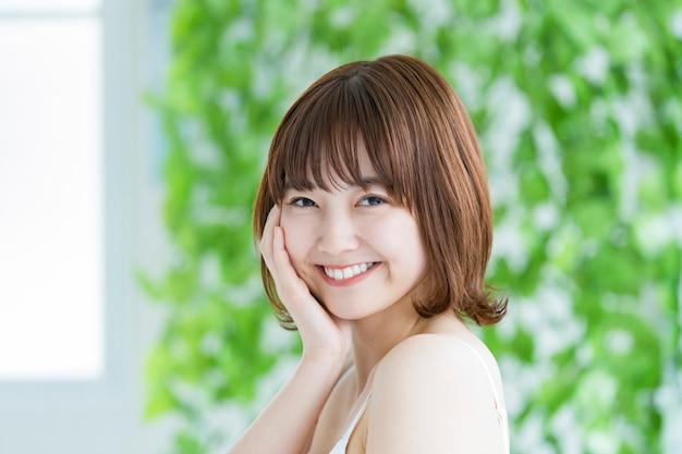 Schoonheidsbeeld / smiley vrouw / groen