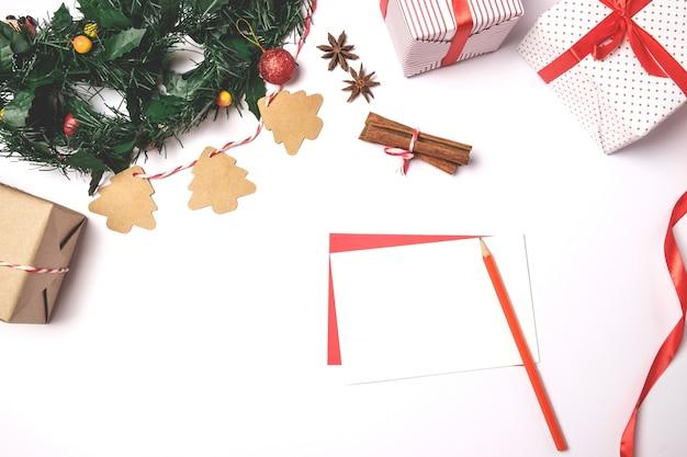 Schrijf wens op de wenskaart en de chrsitmas-kaart.