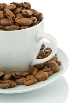 Sectie van witte koffiemok met korrels