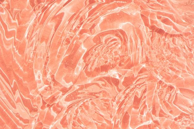 Serumtextuurstaal met collageen en peptiden heldere vloeibare gel met bubbels roze achtergrond
