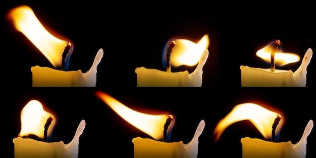 Set kaarsvlammen geïsoleerd op zwarte achtergrond, een verzameling van zes afbeeldingen om op uw foto's te leggen. het vuur brandt, buigt. dansende kaarsvlam. de vlam van een kaars buigt in de wind