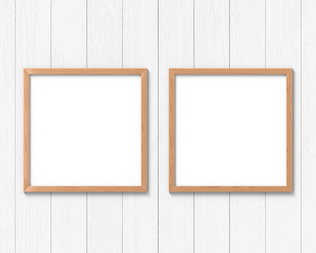 Set van 2 vierkante houten kaders mockup opknoping op de muur