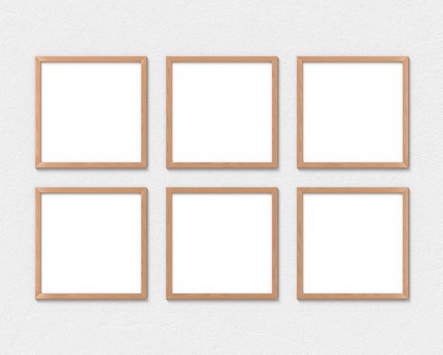 Set van 6 vierkante houten lijsten die aan de muur hangen. 3d-weergave.
