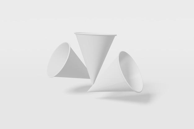 Set van drie witte papieren bekers kegelvormige vlieg op een witte achtergrond