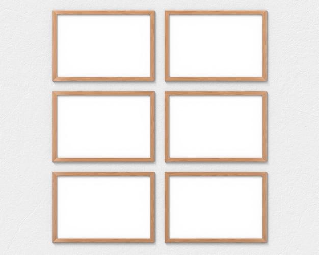 Set van horizontale houten kaders mockup opknoping op de muur