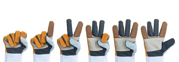 Set van werkende hand in ruwe lederen handschoen