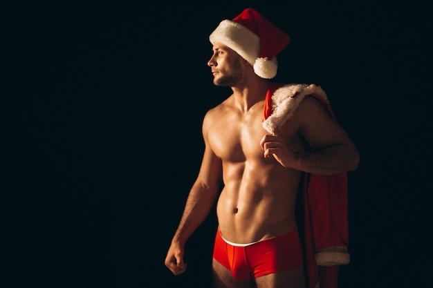 Sexy santa man naakt op zwarte achtergrond