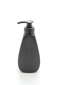 Shampoo of haarveredelingsfles op witte achtergrond