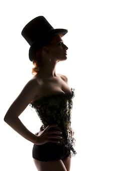 Silhouet achtergrondverlichting foto van sexy vrouw in korset